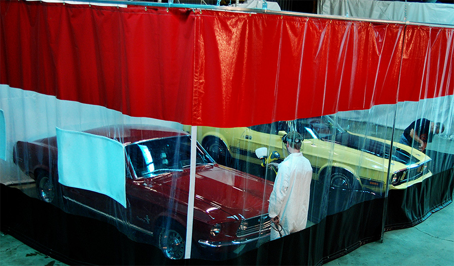 2 men working using industrial curtains in an auto body shop
